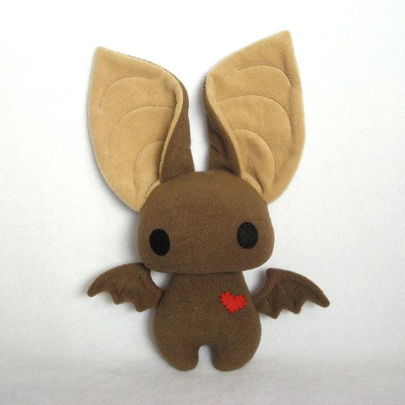 Adorable little bat. Looks like fleece all the way, so soft and cuddly!