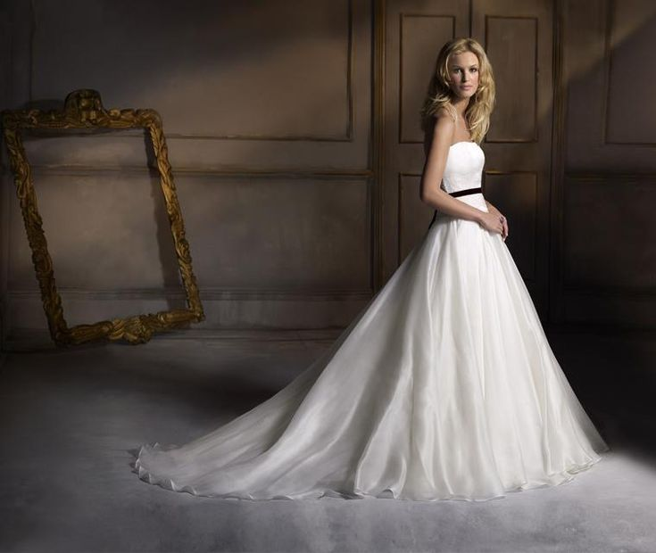 Beauty  Wedding dress features graceful strapless satin bodice with Chantilly lace waistband and organza tulle skirt with black velvet sash.