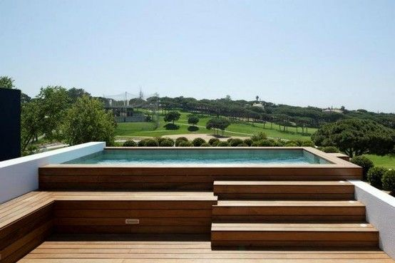 This effect but indoors. Steps and different levels around an above ground pool.