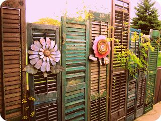 shutters as a privacy fence... Have no idea how or where I would use something like this but super cute!