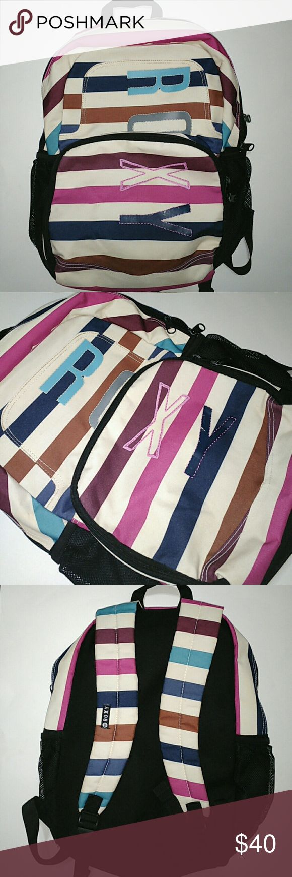 """Roxy Girl Multi Color Stripe  Backpack Roxy Girl Multi Color Stripe  Backpack. Mesh water bottle holder on both sides of bag. Small compartment with small pockets/compartments and large main compartment. excellent condition just some rubbing off of paint on the """"Y"""" of the Roxy label as seen in photos. Roxy Bags Backpacks"""