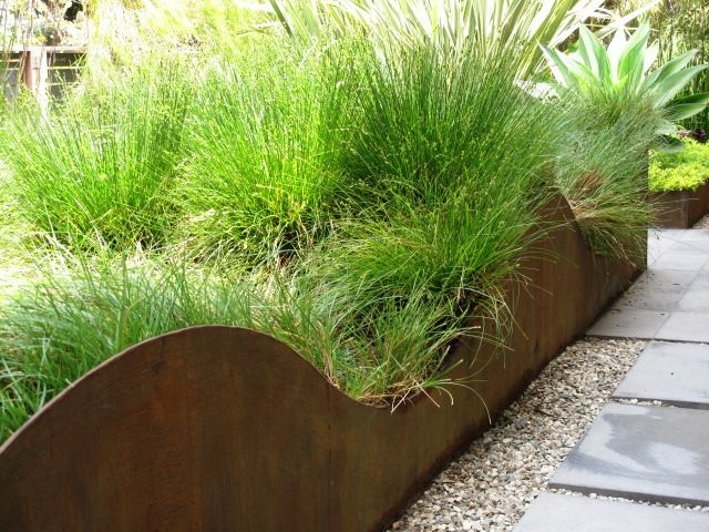 Divided By A Permeable Walkway Of Concrete Tile, The Raised Planters Are  Formed By Boxes Of Thick Steel Plate That Have Been Roughly Finished To  Encourage ...