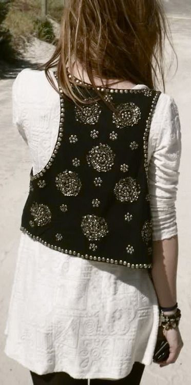 neutral dress with leggings and embellished vest