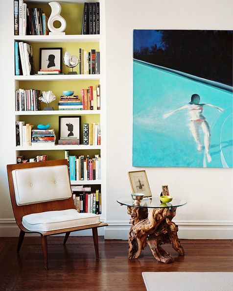Living Room Photo - A midcentury chair beside a wood-base side table with a glass top