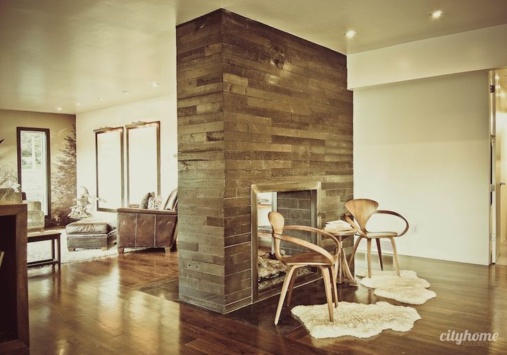 reclaimed wood (?) double sided fireplace wall.  loving the chairs of course and nice warm neutrals