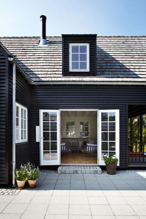 Black exterior with white trim - white french doors