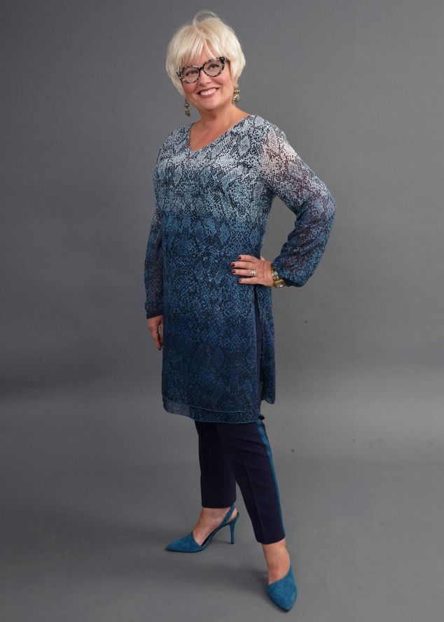 blue dress with pants The earrings are substantial enough to show up with the print of this dress. #accessories course