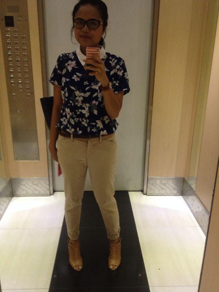 Flower collar blue shirt with khaki pants.