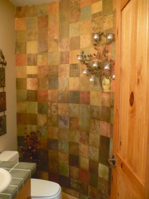Transform a boring wall by using scrapbook paper and bronze glaze. Oh the possibilities...