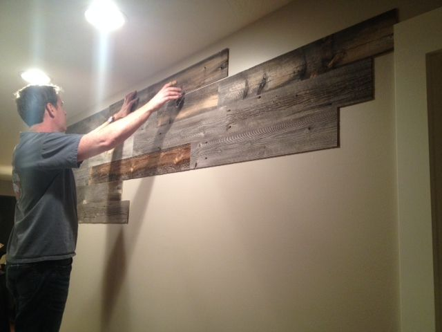 Peel and stick wood wall paneling.