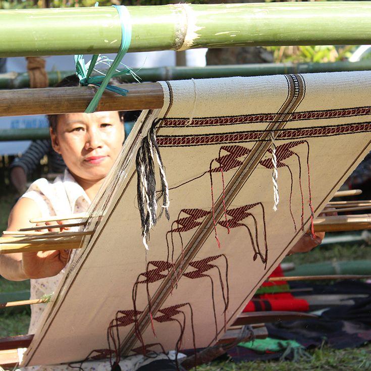 Naga weaver at the Loinloom Festoval, Dima[pur, Nagaland. Backstrap weaving is the traditional way of producing cloth in Nagaland.