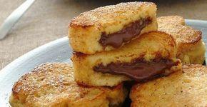 Τηγανίτες με μερέντα για τα παιδιά!  Υλικά  8 φέτες ψωμί για τοστ (ψίχα) 2 κουταλιές της σούπας μερέντα 500 γρ. γάλα εβαπορέ 3 κρόκοι αυγών λίγη βανίλια σε σκόνη 3 κουταλιές της σούπας ζάχαρη ψιλή ζάχαρη κρυσταλλική ή άχνη για το πασπάλισμα μαργαρίνη για το τηγάνισμα     …