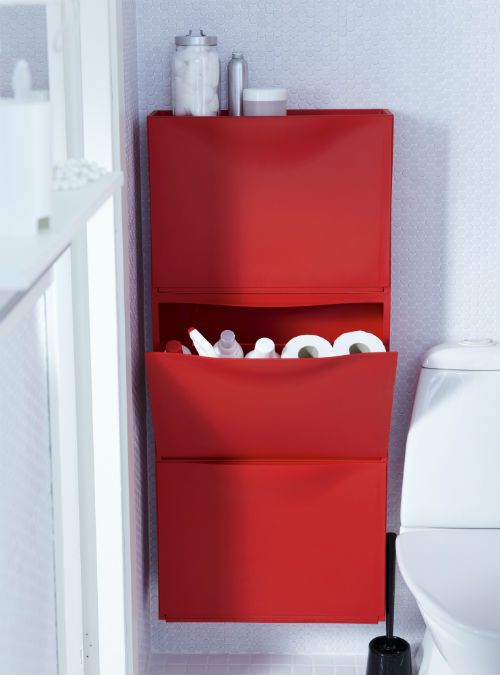 Small spaces call for creative solutions. Store extra shampoo and other bathroom necessities in a slim shoe cabinet.