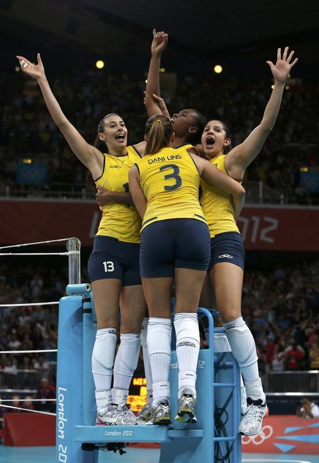 Brazilian women's volleyball team take gold - Brazil's Sheilla Castro, Fabiana Claudino, Natalia Pereira and Danielle Lins celebrate on the referee stand after winning their women's gold medal volleyball match against the U.S. at Earls Court during the London 2012 Olympic Games August 11, 2012. REUTERS/Marcelo Del Pozo