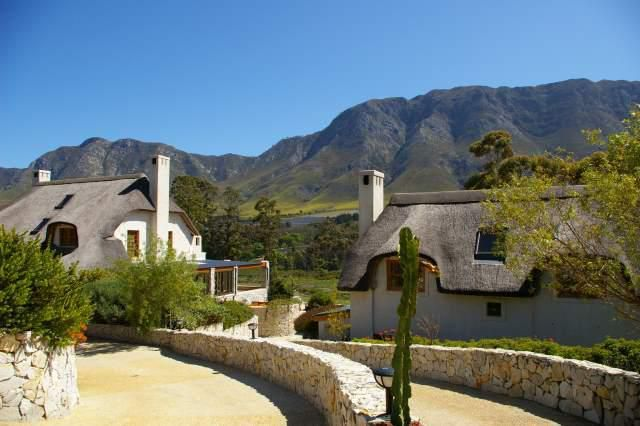 6 bedroom house for sale in Hemel En Aarde Valley. The main house and guest cottage face north, offering sweeping views of meadows, wetlands and the river.