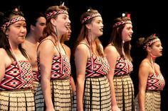 Our inspiration look - traditional Maori. We will be wearing tops made from nonMaori fabrics with faded jeans. Examples will be posted here. Wear your headband like these ladies - across the forehead. Unlimited amounts of jewelry. Appropriation is not the intention here. Keep in mind that our costumes are meant to be a nod to all tribal communities without making offence.
