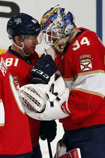 SUNRISE, FL - MARCH 25: Goaltender James Reimer #34 of the Florida Panthers and teammate Jonathan Marchessault #81 celebrate their win against the Chicago Blackhawks at the BB&T Center on March 25, 2017 in Sunrise, Florida. (Photo by Eliot J. Schechter/NHLI via Getty Images)