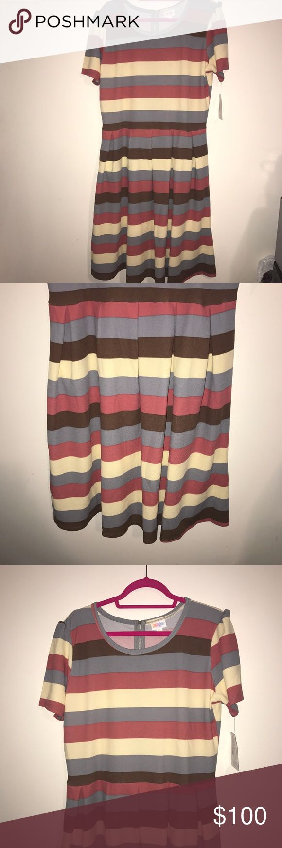 HTF NWT LuLaRoe 3X Amelia Dress Horizontal Stripes SUPER RARE and Hard to Find BNWT LuLaRoe 3X Amelia Dress in Horizontal Stripes! Similar to the dress worn on This is Us!  Stunning in Brown, Blush Pink, Cream, and a light Slate Blue. Perfect for everything from a wedding to brunch to the holidays! Amelia's are thicker material dresses & have pockets, zippered backs, puff sleeves, & box pleated skirts. Gorgeous! Ask me with any questions before purchase! LuLaRoe Dresses
