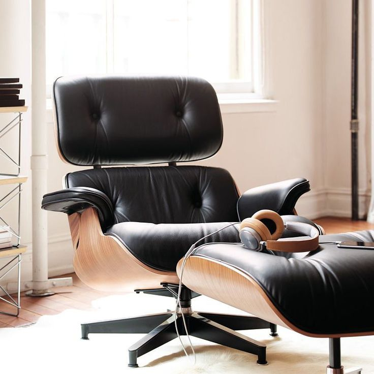 Tall Eames Lounge Chair & OttomanCombining soft, inviting leather with the sleek form of molded wood, the Eames Lounge Chair and Ottoman is the culmination of the Eameses' efforts to create a club chair using the molded plywood technology they pioneered in the '40s. Even today, each piece is assembled by hand to ensure the highest level of quality and craftsmanship. The configuration of this set is a registered trademark, and this is the authentic Eames Lounge Chair and Ottoman by Herman…