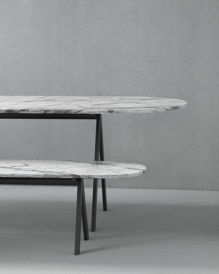 Saw Series of tables and benches - use indoors and outdoors. Available in marble and wood from Danish brand Friends & Founders