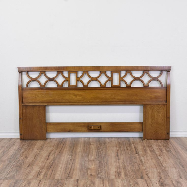 """This """"Drexel Heritage"""" headboard is featured in a solid wood with a glossy walnut finish. This king sized headboard is in great condition with carved trim and a circular geometric pattern. Eye catching headboard perfect for a large bedroom! #traditional #beds #headboard #sandiegovintage #vintagefurniture"""