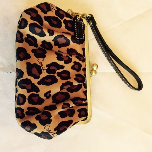 "Coach Leopard Wristlet/ Clutch JUST RIGHT FOR FALL! Adorable Leopard print Coach wristlet/ clutch. Purchased for a cruise and not used since. Hot pink interior. Perfect condition! Approximately 7.5"" x  4""x2.5"". Coach Bags Clutches & Wristlets"