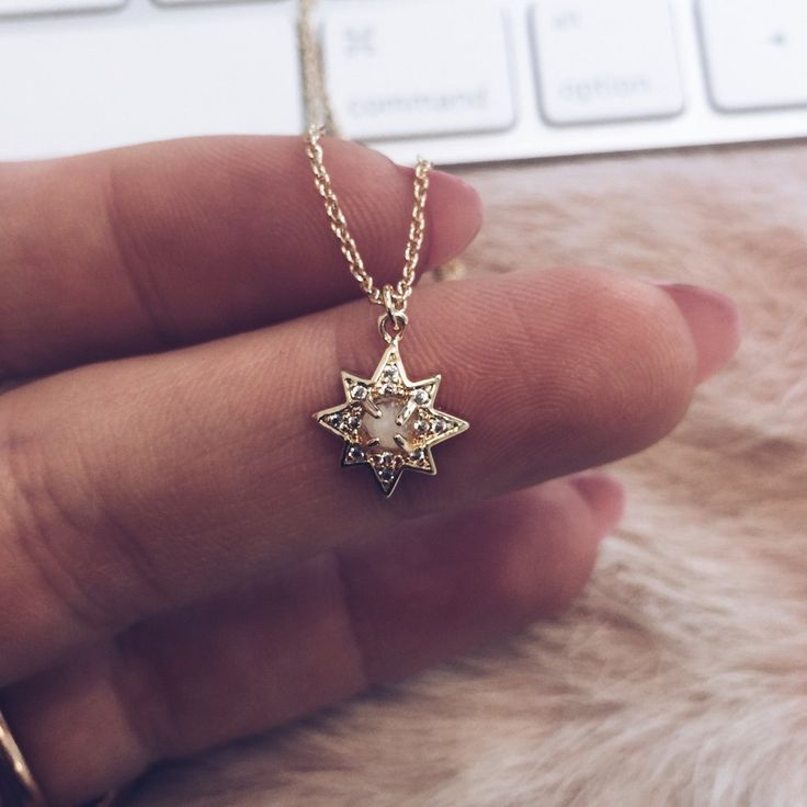 """Starburst pendant necklace that hits just above your collarbone and adds the perfect bit of sparkle to your day. - 14"""" chain with a 2"""" extender - Pendant necklace - Faceted moonstone - Pave cz stones"""