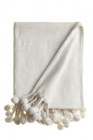 Pom Pom Throw in white. I would love a some of these for our sofa for Family Movie Nights.