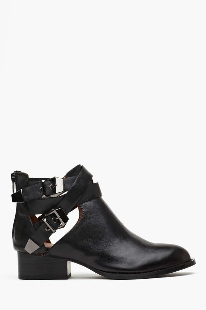"Jeffrey Campbell: Everly Cutout Boot / "" Totally necessary black leather ankle boots featuring side cutouts and strapped detailing with gunmetal buckles. Low stacked heel, zip closure at back. Genuine leather lining..."""