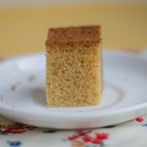 How to make Basic Eggless Vanilla Sponge Cake Recipe. Very soft, moist, tender and fluffy. Best plain vanilla base cake recipe. With step by step pictures.