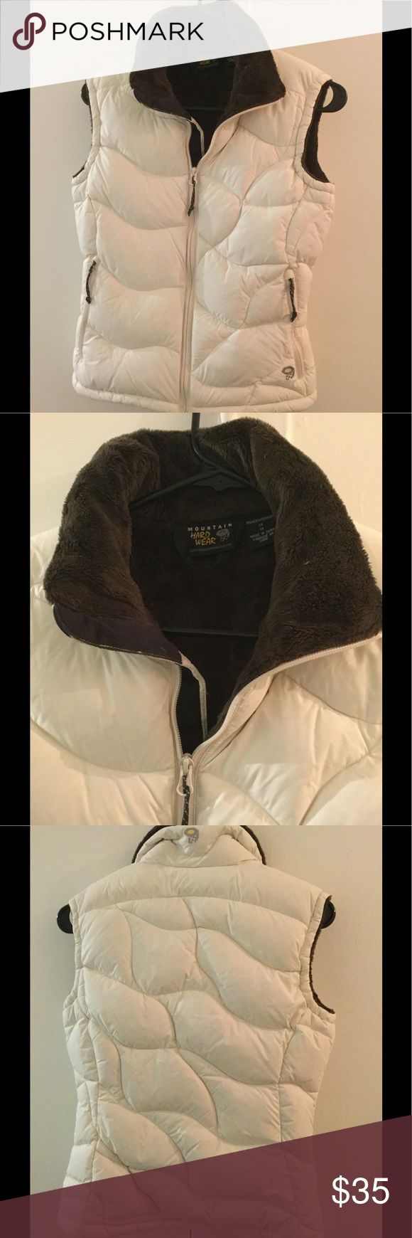 Mountain Hardware Puffer Vest Mountain Hardware Puffer Vest. Gently used, no stains or damage. Ivory colored shell and deep brown faux fur lining. Perfect for early Fall. Mountain Hardwear Jackets & Coats Vests