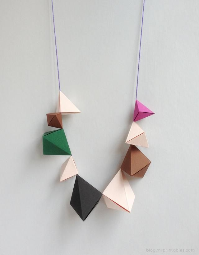 Here's a statement necklace that won't weigh you down: it's made of nothing but folded paper and string. (Keeping the color palette funky and modern is what makes this #DIY jewelry adult-appropriate.)