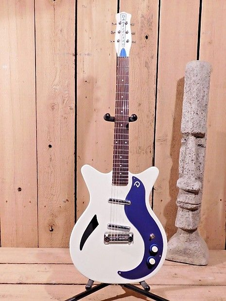 """At Top 40 Guitars our customer's satisfaction is our first concern.All our items we sell have a 14 day return policy.If after 14 days you are not happy with the item, please return it for a refund.(Less 10% restocking fee)*all returned items must include original packing.Peace be with you...Up For Sale is Danelectro '59M Spruce Electric Guitar                White with Blue Pick Guard!Display model. Sold as """"New Other"""" because they show very minor signs of bein..."""