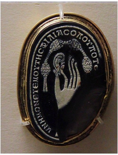 Cameo made from a pebble, Roman, 2-3c AD With Greek inscription : 'Wherever you are, remember me (and) the love (I bear you)'