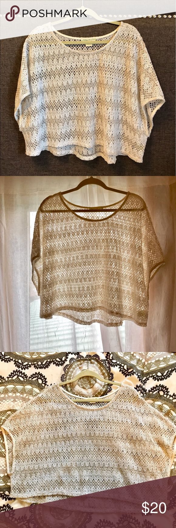 ANTHROPOLOGIE neutrally- sheer oversized crop Polyester & rayon, beautiful sheer knit crop tee, oversized fit, oversized armholes, slight high -low hem. White/ivory detailing throughout. This is a reposh from an amazing posher! Condition: NWOT. Measurements on photos; any questions and offers welcomed ! Anthropologie Tops Crop Tops