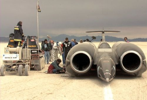 "Thrust SSC  763 miles per hour (mach 1.02)... fastest ""automobile"" on the planet."