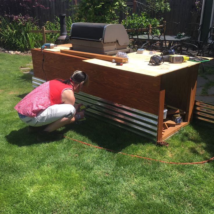 My son Trebor adding the corrugated aluminum to the BBQ station.