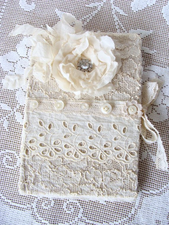 Soft and romantic - hardback book is covered with vintage and new laces over scrim. Lace trim wraps around the book and ties to keep the book closed.