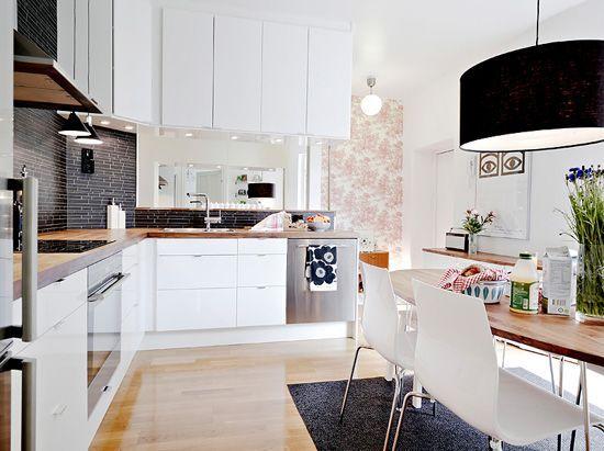 White kitchen with black tiles