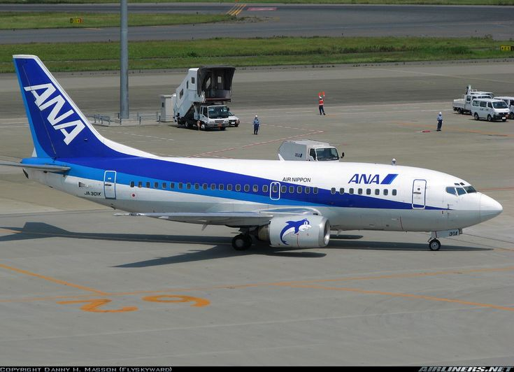 ANA Airways (All Nippon Airways) (JP) Boeing 737-54K JA301K aircraft, with the stickers ''Air Nippon'' & ''a dolphin'' in each engine, rolling at Japan, Tokyo Haneda Int'l Airport. 04/06/2007.