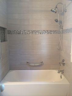 Tile tub surround. Gray tile around bathtub. Grey tile around bathtub.