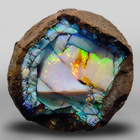 """Ethiopian opal geode  sometimes you feel like a rock: hard, angry, damaged.  But sometimes there is an opal inside you: this otherworldly beauty, the potential to be soft and loving and kind"""