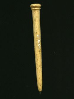 Stylus This stylus is made from bone, and has a flat head. This head has been hand-decorated with dots and various incised lines. Below the head are two prominent ridges, with a smaller one in the middle. The shaft is round and tapers slightly towards the metal tip. Styli and wax tablets were used for writing as early as the Classical Greek period, and this stylus is medieval.  Production Date: Late Medieval; 14th-15th century