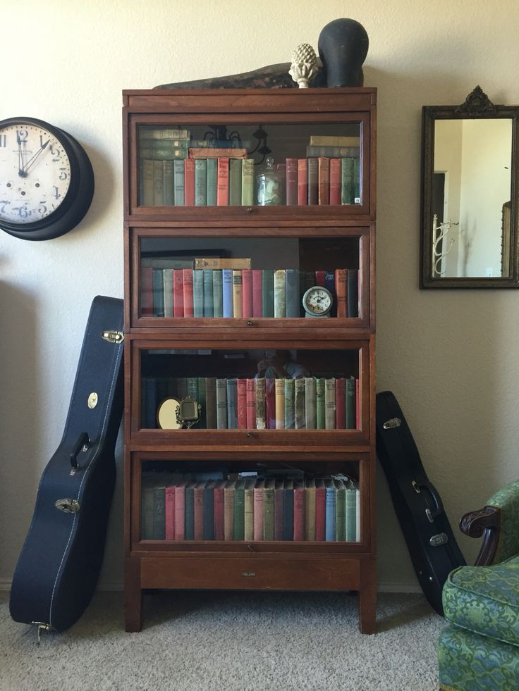 Lawyers bookcase full of vintage books in music room.