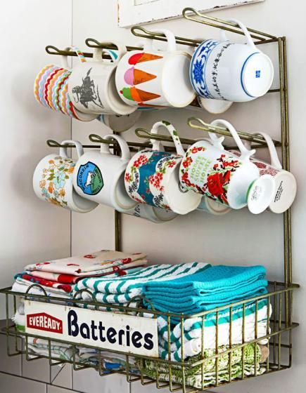 A retro battery rack becomes a clever holder for a coffee cup collection. More photos from this kitchen: http://www.midwestliving.com/homes/decorating-ideas/low-cost-country-kitchen-ideas/?page=6