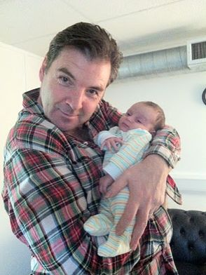 Downton Abbey's Mr. Bates -- as himself, Brendan Coyle, holding a baby