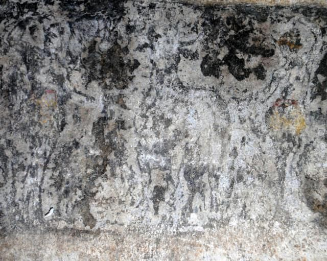 Amphipolis, Macedonia Greece - 2nd chamber - The figures on the architraves - The restoration of the 7 architraves, found in the 2nd Chamber, is under development and the good news is that some figures have appeared. The photo shows an animal in the middle, maybe a bull, along with with a man (left) and a woman (right).