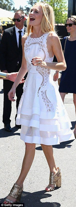 British model and socialite Poppy Delevingne looked beautiful in a demure white dress with gold accessories
