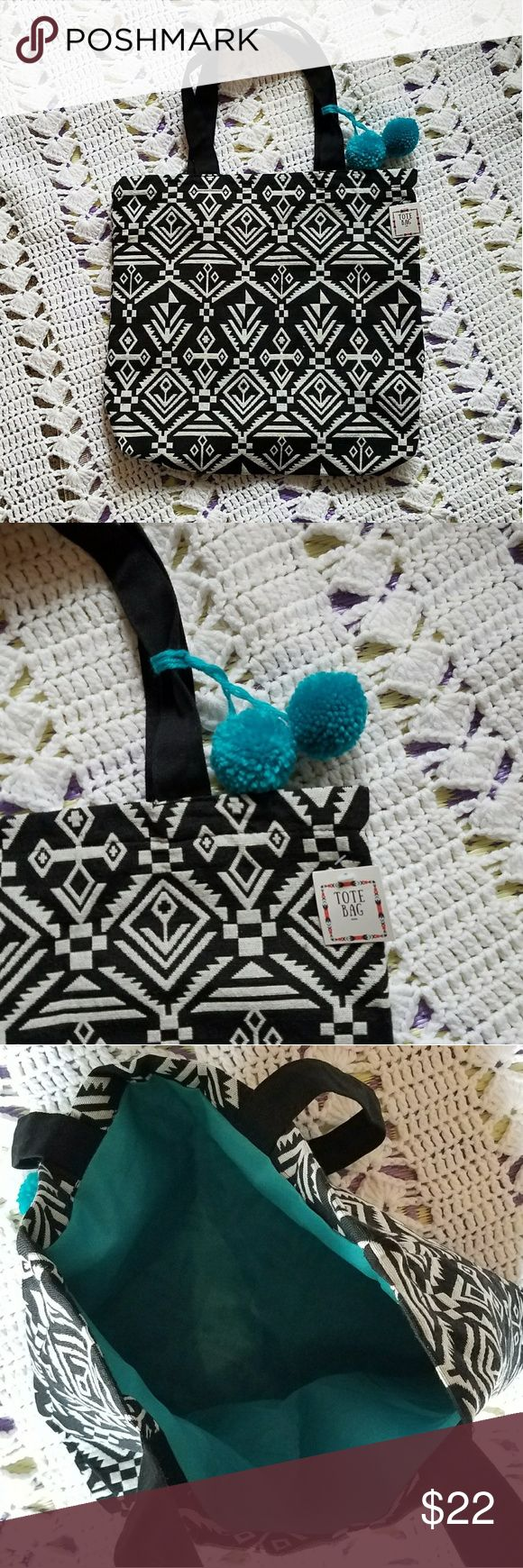 """NWT Lularoe Black & White Tote Bag Brand new Luluroe. Blue pom poms on the handle, tribal print exterior and blue interior. Make it your next beach bag! Original price $35.  Measurements added in photos. Handle has a 7.5"""" drop.  Any questions ask! :) LuLaRoe Bags Totes"""