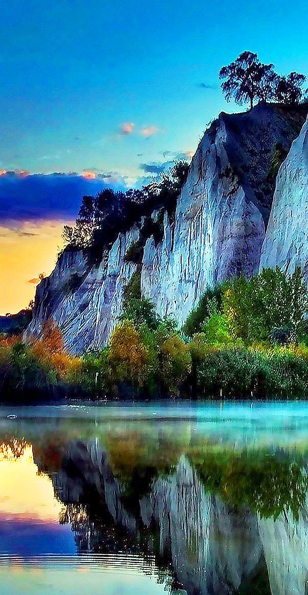 I love how this cliff reflects in the lake!